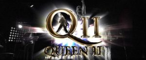 Queen II written in gold writing with bright lights behind it as well as a faint image of Freddie Mercury behind the text.