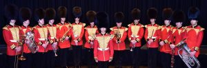 London Militray Band members, red gold and black outfits, verity of instruments