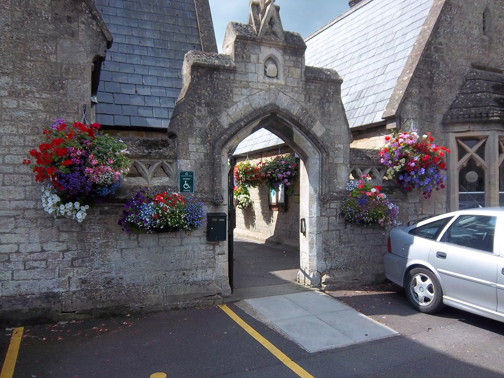 London Road Cemetery entrance, hanging baskets with different coloured flowers