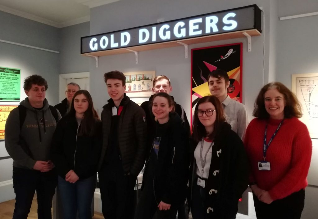 Group of students in Goldiggers exhibition
