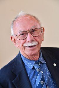 Councillor Andy Phillips, glasses, blue shirt, blue tie, blue jacket