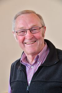 Councillor David Powell, Glasses, Red and blue shirt
