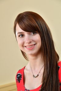 Councillor Holly Bradfield, Red top, necklace
