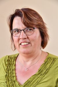 Councillor Jenny Dudgell, Glasses, Green top, silver necklace