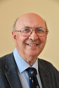 Councillor John Scragg, Glasses, Blue shirt, Blue tie