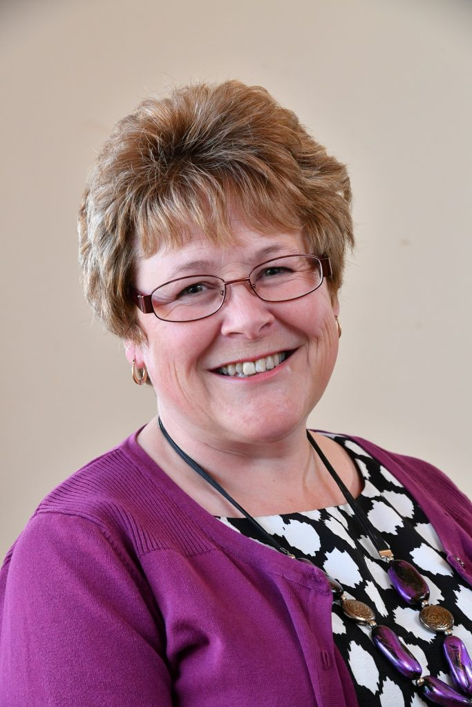 Councillor Teresa Hutton, Glasses, Purple jumper, Black and white top