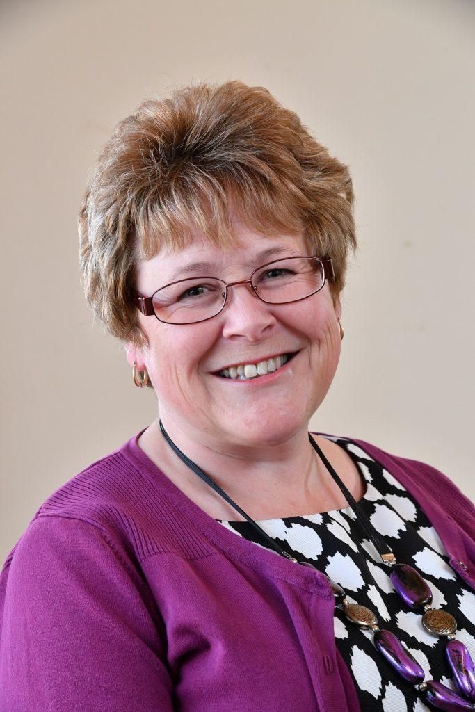 Councillor Teresa Hutton, Glasses, Purple jumper, Black and white top
