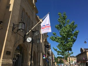 Chippenham Town Council Town Hall, Blue sky, green tree, Armed Forces Day white blue and red flag