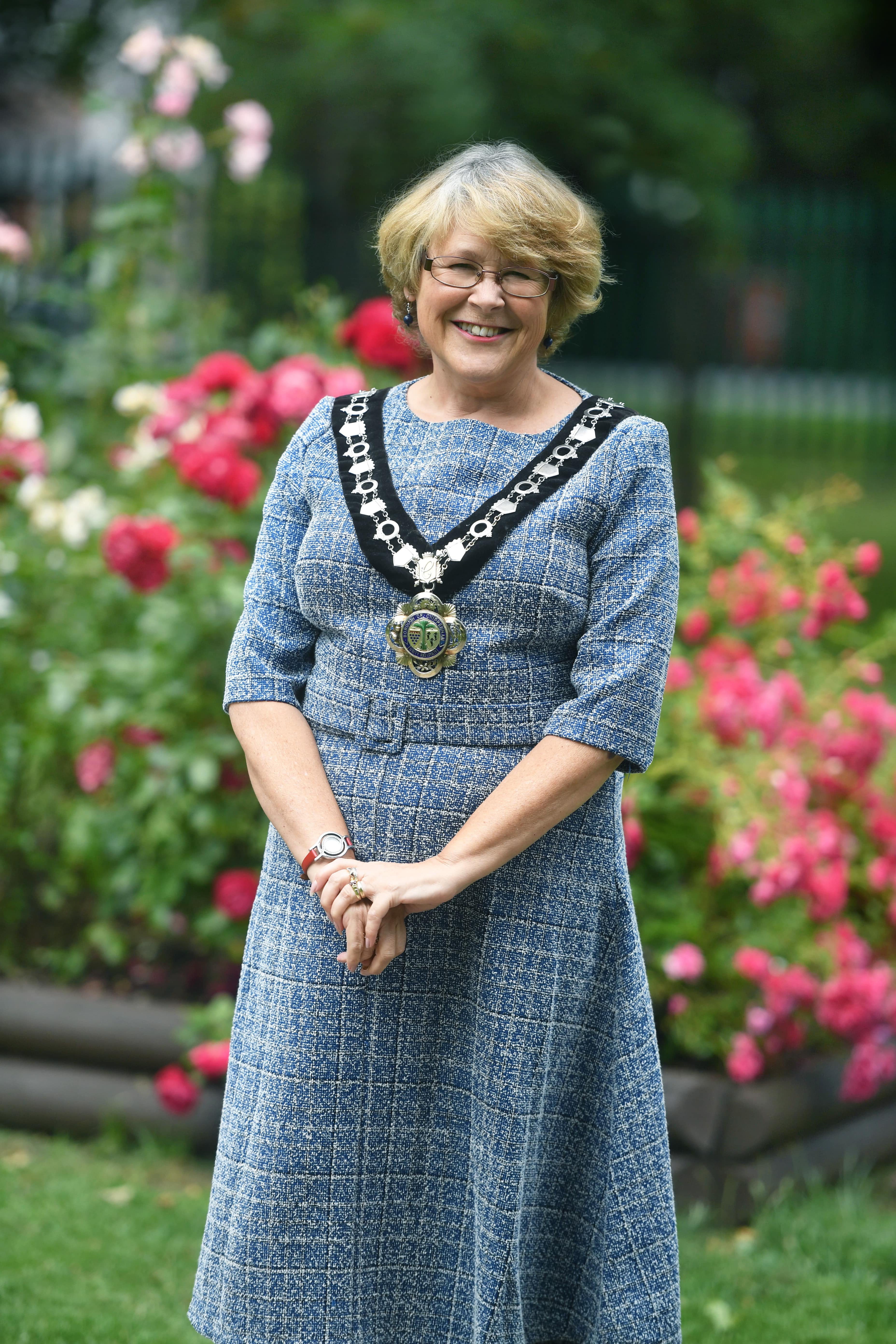 Mayor of Chippenham Councillor Teresa Hutton standing outside on the park wearing her official mayoral chain of office