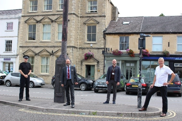 representatives from Wiltshire Council, Wiltshire Police and Chippenham Town Council all standing next to the new CCTV camera at the top of a lamp post in the town centre