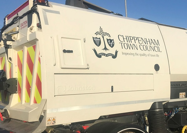 White road sweeper with Chippenham Town Council logo on the side