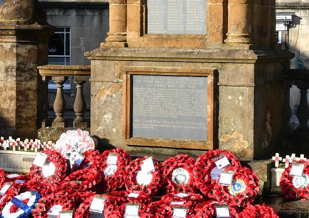 Chippenham War Memorial surrounded by red poppy wreaths for remembrance day 2019.