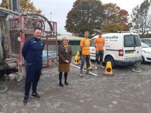 Mayor of Chippenham, Councillor Teresa Hutton standing socially distanced with the borehole workers and Head of Leisure Services Paul Harvey at Stanley park Sports Ground