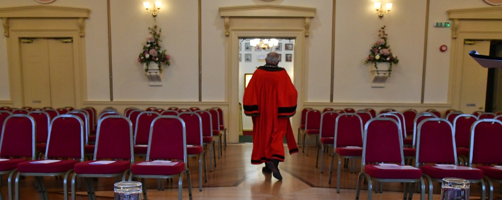 Mayor of Chippenham walking out of the Town Hall in the Mayoral robes