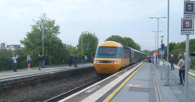 HST arriving at station with people looking on platform