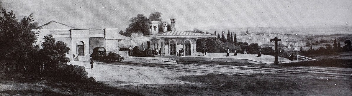 A monochrome illustration of the station and platform, with the town visible in the background