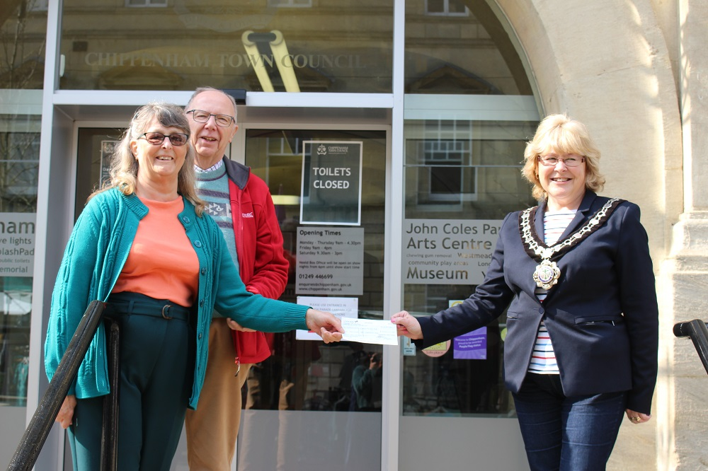 Mayor of Chippenham stood with representatives of Ivy Wildlife Garden on the Town Hall steps whilst they receive their community donation cheque