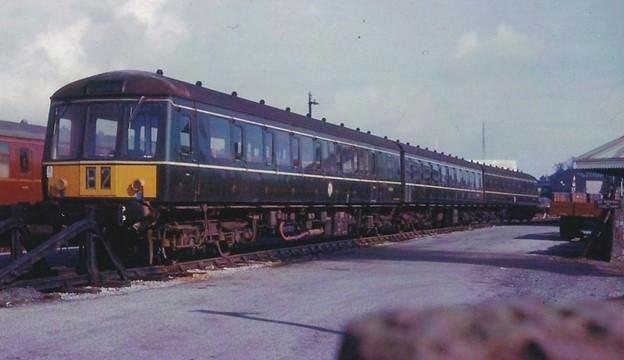 colour photograph of diesel train in station siding