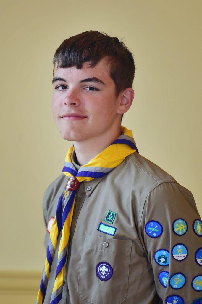 Explorer Scout Alaric Childerhouse oin his official Explorer Scout uniform