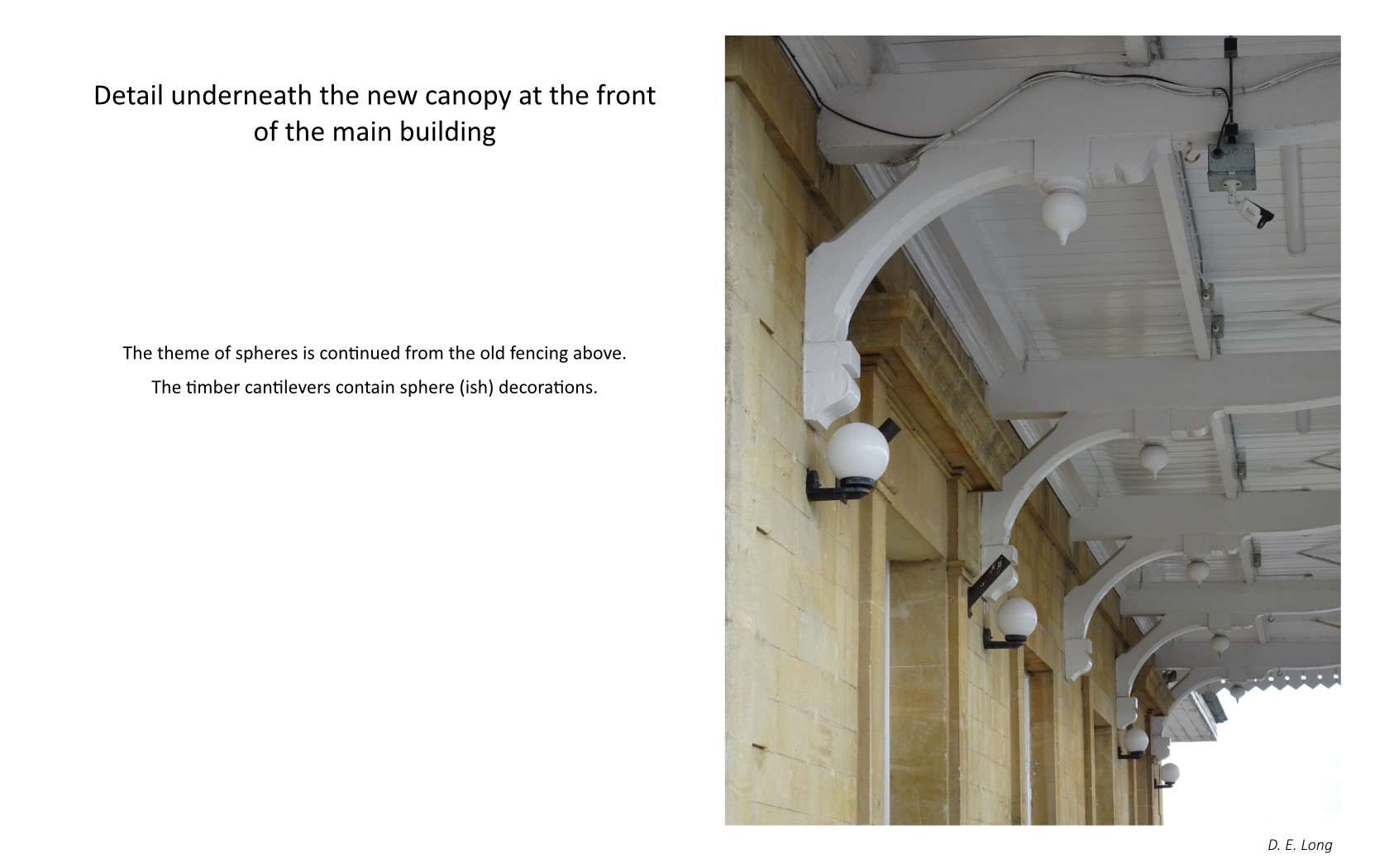 Photo looking up toward the station roof showing detail. Caption, detail underneath the new canopy at the front of the main building . The theme of spheres is continued from the old fencing above . The timber cantilevers contain speherish decorations.