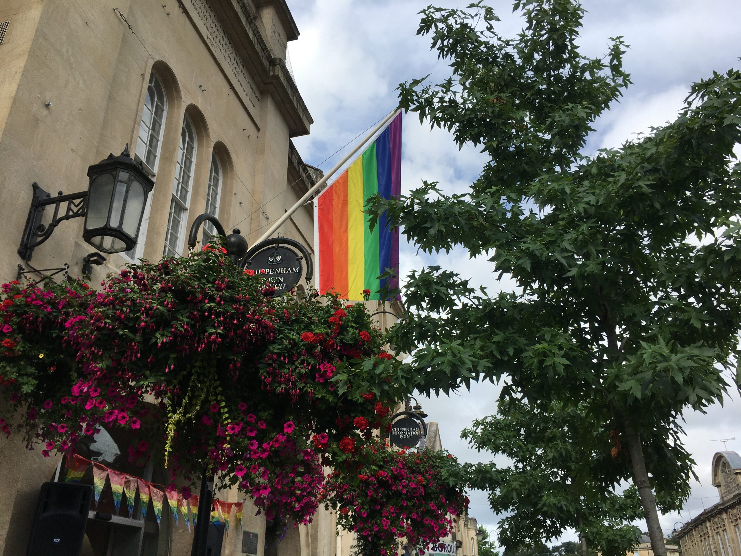 Pride flag which consists of red, orange, yellow, green, blue and purple stripes raised at the Town Hall